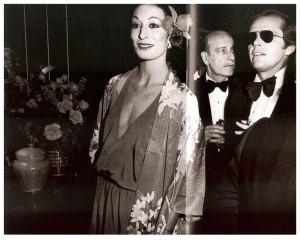 Again with said bow tie and aviators, but Anjelica is being effortlessly fabulous with a flower in her hair!