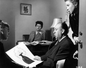 Costume designer Edith Head, director Alfred Hitchcock and Ingrid Bergman discuss Bergman´s wardrobe in Notorious