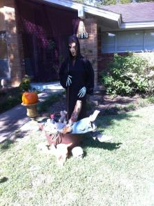 My Mom decorated out front with our cauldron and body parts from the old spook house!