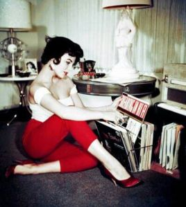 Looking effortlessly sexy while glancing at records.