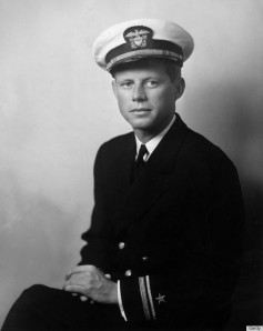 Portrait of John F Kennedy, war hero, future US senator, and president, wearing his U.S. Navy uniform and posing with his hands in his lap, World War II (1939-1945), circa 1940. During the war, Kennedy served as a PT boat commander in the Pacific, earning medals for rescuing most of his crew after their boat was sunk in action. (Photo by Frank Turgent/Hulton Archive/Getty Images)