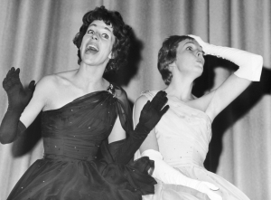 American actor and comedian Carol Burnett (left) and British actor Julie Andrews sing in formal gowns in a promotional still from the 1965 CBS television variety special 'Julie and Carol at Carnegie Hall,' New York City. The special traced the history of musical comedy.  (Photo by CBS Photo Archive/Getty Images)