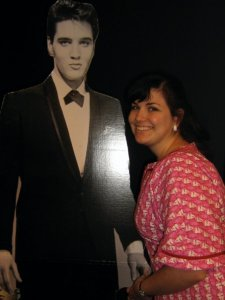 I can stop whenever I want to! (But I don't!) Yes, I'm holding the cardboard cutout's hand.