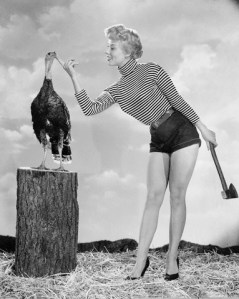1954, Film starlet Adelle August charms a turkey, with clearly homicidal intentions - Image by © Bettmann/CORBIS
