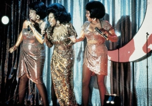 The gritty, sexy mistress of a mob boss, Deloris van Cartier could wear the hell out of a gold sequined gown!