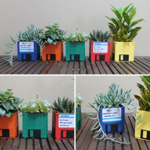 Upcycling! There is absolutely no reason to keep those floppy disks, unless you're going to make them into adorable little planters (or fat vases/candle holders/makeup brush holders, etc.), and give them to people as gifts!