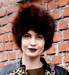 As the recipient of a similar fur hat this past Christmas, I think this is GREAT! Her dark lips make this an elegant statement, and it's super funky!
